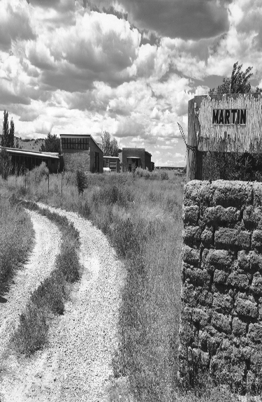 "Agnes Martin. 216B-065-087 Gallistea, NM, USA 1992 Vogue. November 1992. pp. 307 ""The entry to the artist's compound near Santa Fe."""