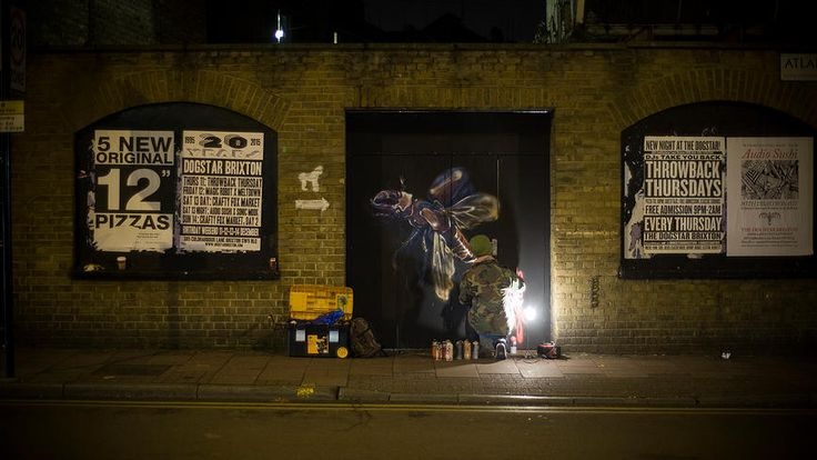 Street artist Louis Masai paints the Stag Beetle on Atlantic Road, Brixton 19.11.14 as part of a campaign by the IUCN and Synchronicity Earth to raise greater consciousness about human impact on UK animals